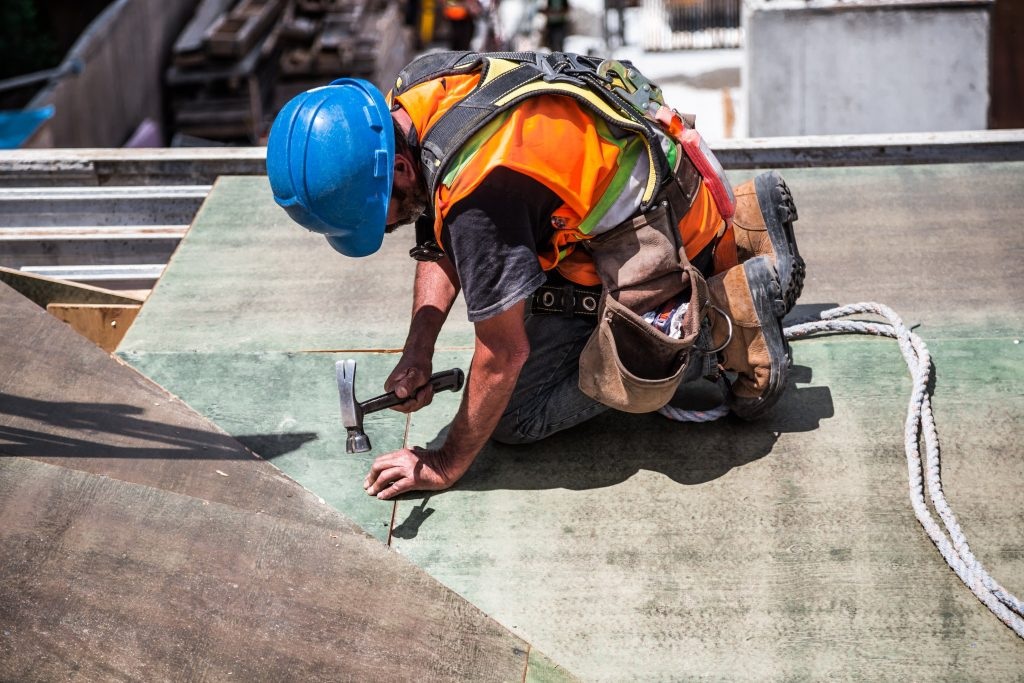 Construction worker doing roofing